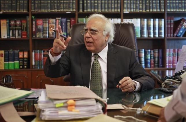 Congress leader Kapil Sibal gestures after an interview with Reuters in New Delhi October 15, 2013. REUTERS/Anindito Mukherjee/Files